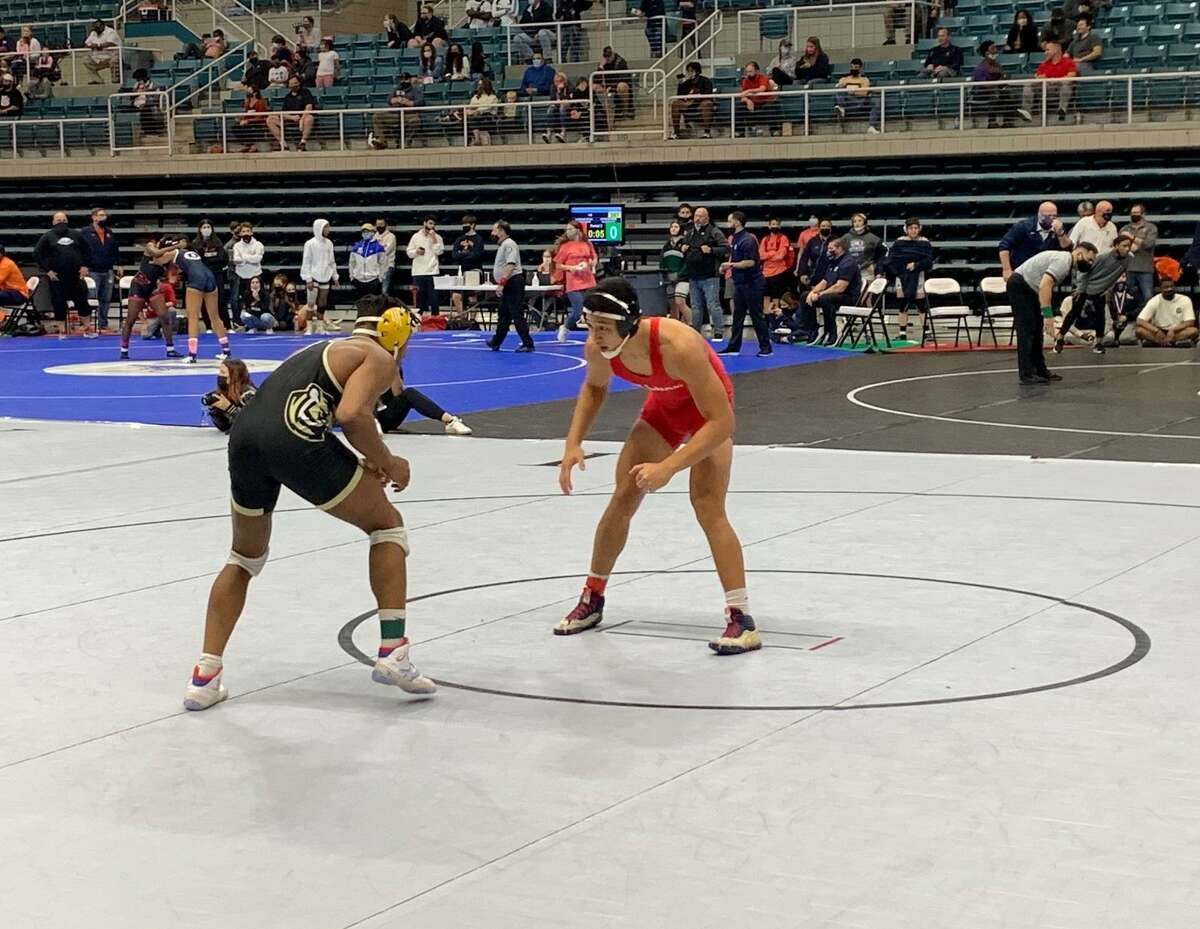 Bellaire's Jamey Duong and Cypress Park's Avante Williams compete for the 170-pound bronze medal at the Region III-6A tournament April 17 at Merrell Center.
