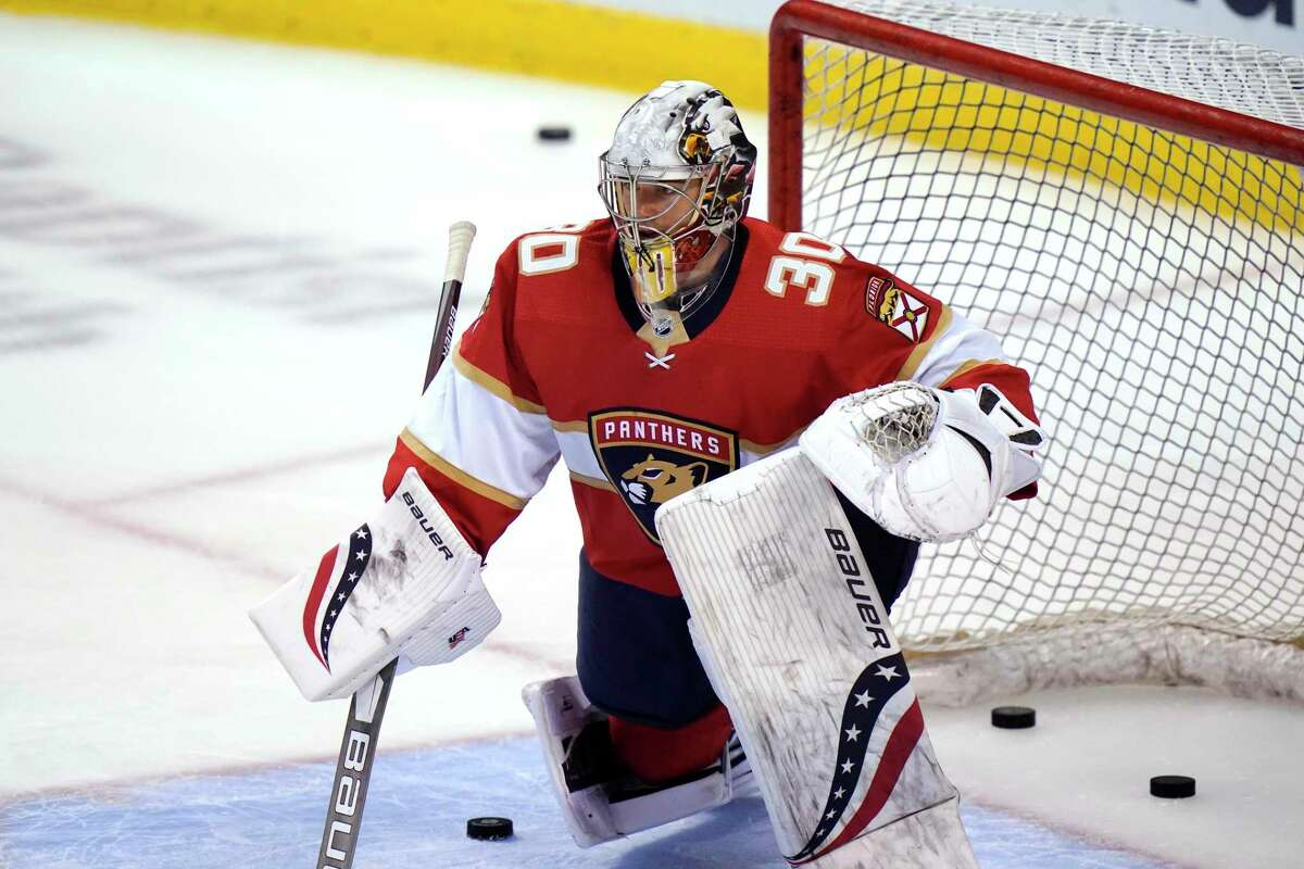 Florida Panthers goaltender Spencer Knight (30) warms up before an NHL hockey game against the Columbus Blue Jackets, Monday, April 19, 2021, in Sunrise, Fla. (AP Photo/Lynne Sladky)