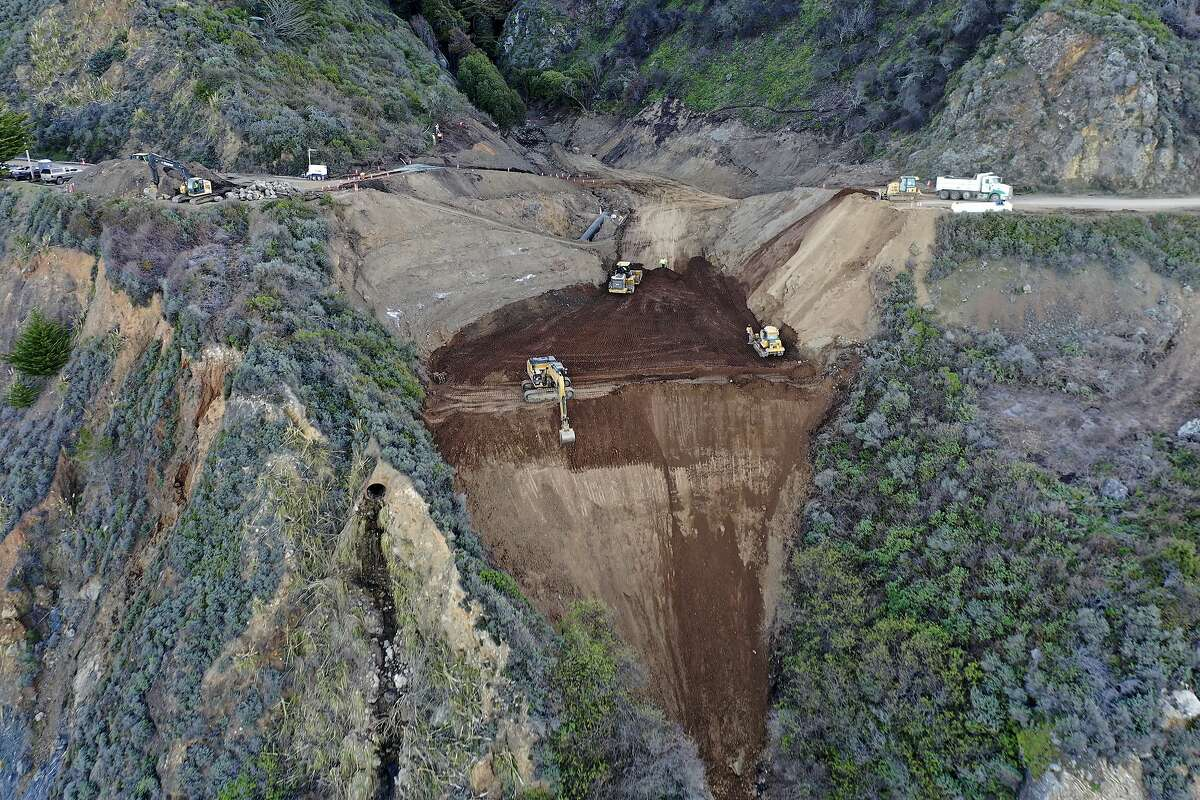 In this March 24, 2021, photo provided by the California Department of Transportation, construction crews repair a section of Highway 1 in Big Sur that was washed away during a winter storm.