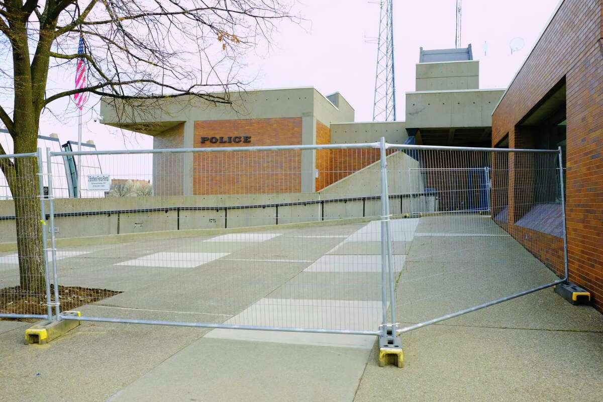 Fencing blocks off an area in front of the Schenectady Police Station, seen here on Tuesday, April 20, 2021, in Schenectady, N.Y. (Paul Buckowski/Times Union)