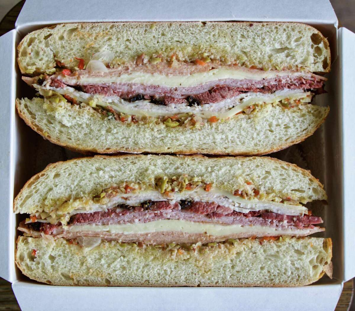Brett's Barbecue Shop in Katy has created its own Texas Smoked Muffuletta made with house-smoked meats (pastrami, turkey breast, bologna and ham), Havarti and Provolone cheeses and hot giardiniera/olive/red pepper salad on an Italian round loaf.