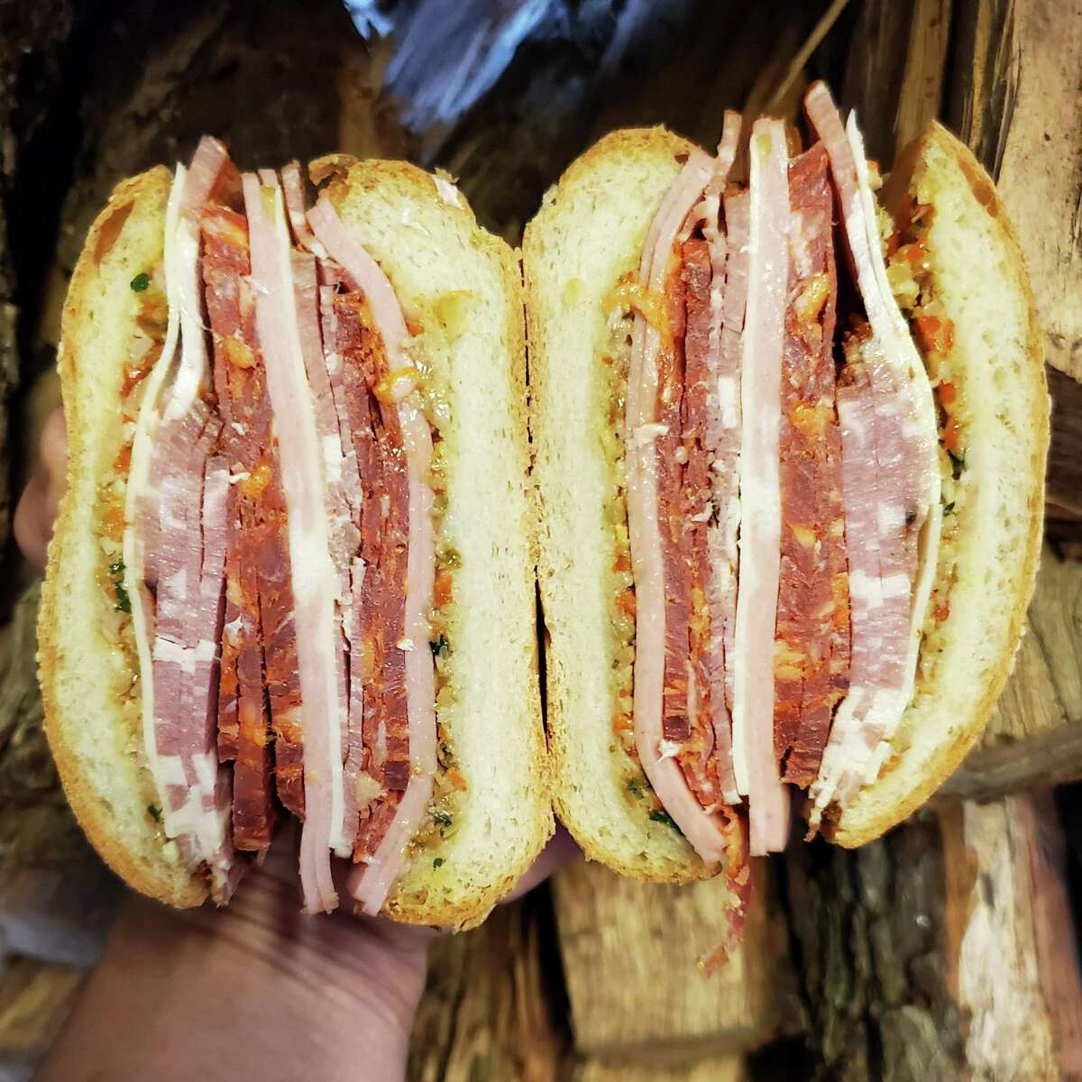Blood Bros. BBQ has created a new muffuletta sandwich made with house-made smoked capicola, mortadella, soppressata, provolone and olive spread. It will come on the menu as an occasional special.