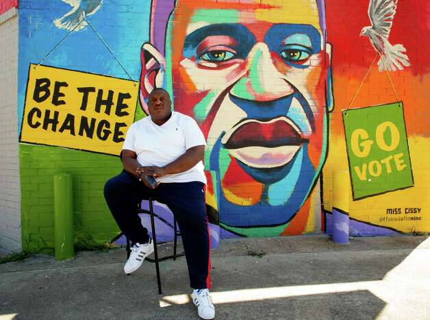 Travis Cains in front of a George Floyd mural on Tuesday, April 20, 2021, in Third Ward, Houston. Cains, also known as Mugz, grew up with Floyd in Cuney Homes. He says watching the trial has been a struggle, but he is feeling optimistic that former Minneapolis Police officer Derek Chauvin will be found guilty. Photo: Godofredo A. Vásquez, Houston Chronicle / Staff Photographer / © 2021 Houston Chronicle