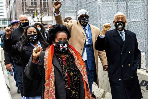Members of George Floyd's family and Rev. Al Sharpton (R), arrive at the Courthouse In Minneapolis, Minn. on April 19, 2021. Photo: AFP Contributor#AFP, Contributor / AFP Via Getty Images / AFP