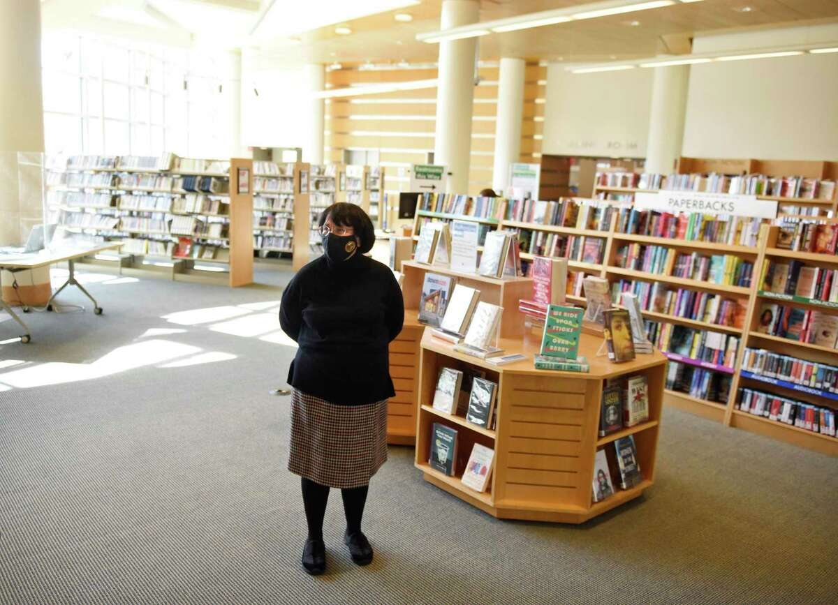 Greenwich Library Director Barbara Ormerod-Glynn speaks inside the newly-renovated Greenwich Library in Greenwich, Conn. Tuesday, April 20, 2021. More than a year after it was forced to close its doors due to the COVID-19 pandemic, Greenwich Library has welcomed back the public by appointment only for 20 minute visits. Patrons will be welcomed back to the library's sleek new look, which includes a new cafe and major interior renovations.