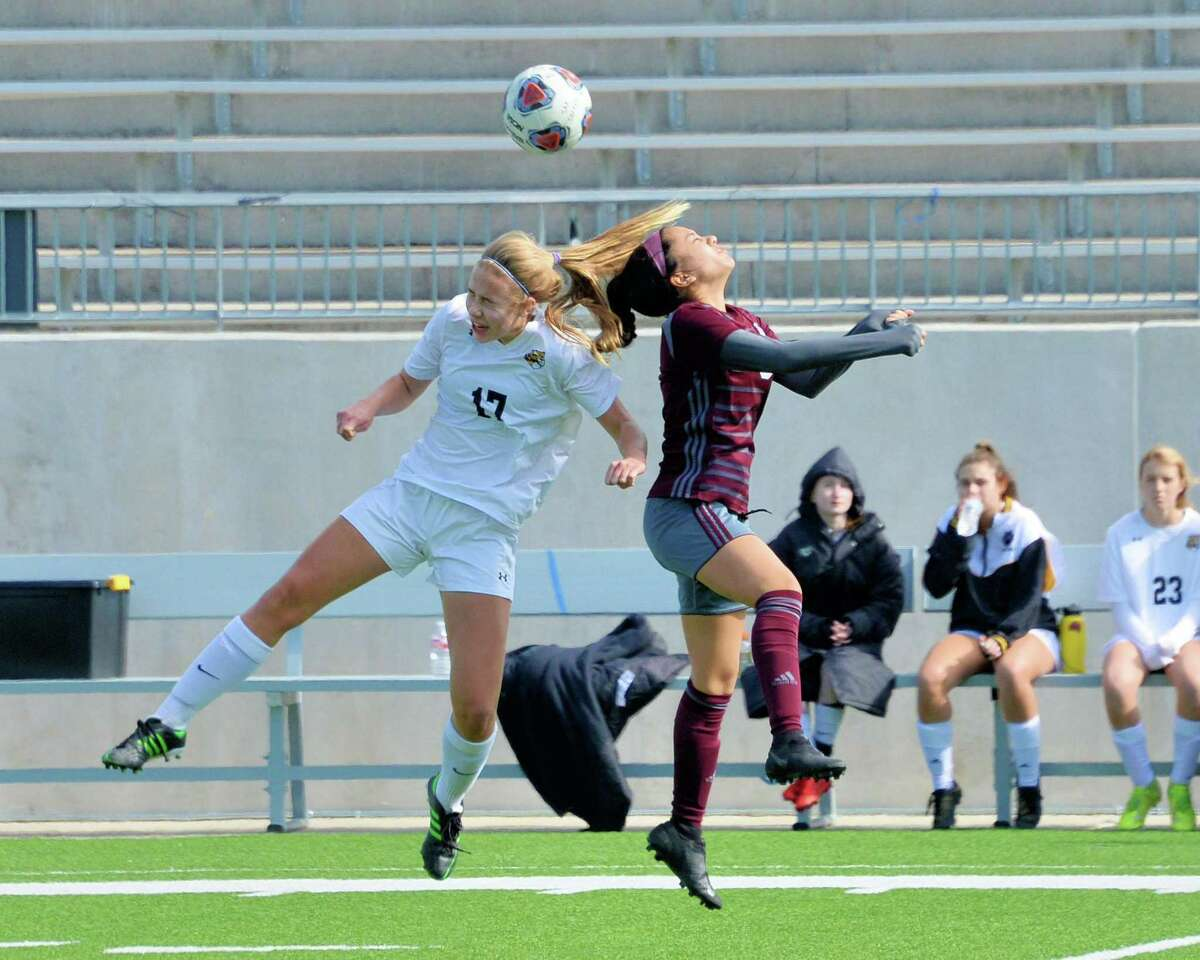 Kristin Geczik (17) of St. Agnes and Gaby Vanegas (5) of Cinco Ranch compete for a head ball during the first half of a high school soccer game between the Cinco Ranch Cougars and the St. Agnes Tigers in the Cougar Bracket final of the I-10 Shootout on Saturday, January 11, 2020 at Legacy Stadium, Katy, TX.