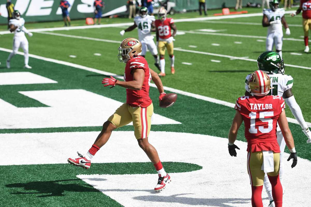 EAST RUTHERFORD, NEW JERSEY - SEPTEMBER 20: Jordan Reed #81 of the San Francisco 49ers reacts after scoring a touchdown during the first half against the New York Jets at MetLife Stadium on September 20, 2020 in East Rutherford, New Jersey. (Photo by Sarah Stier/Getty Images)