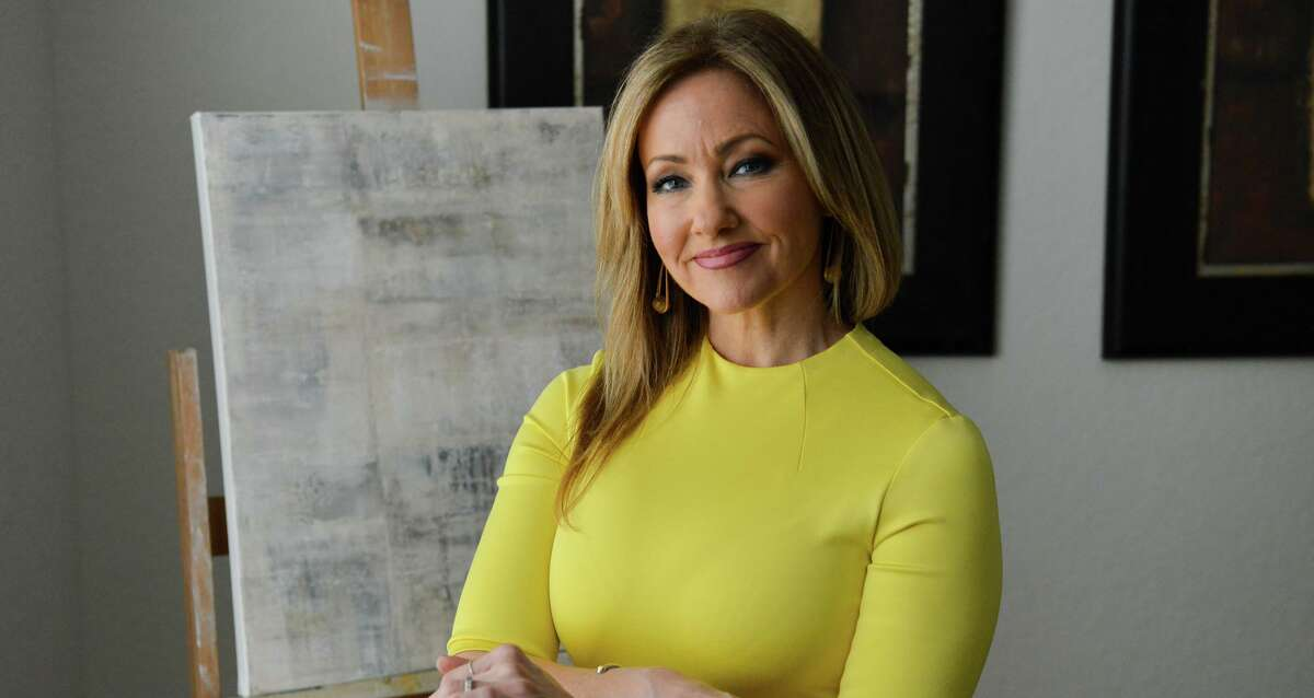 After 16 years at WOAI, anchor Delaine Mathieu disappeared from the airwaves without a trace in March. Here she stands in front of one of her latest paintings.