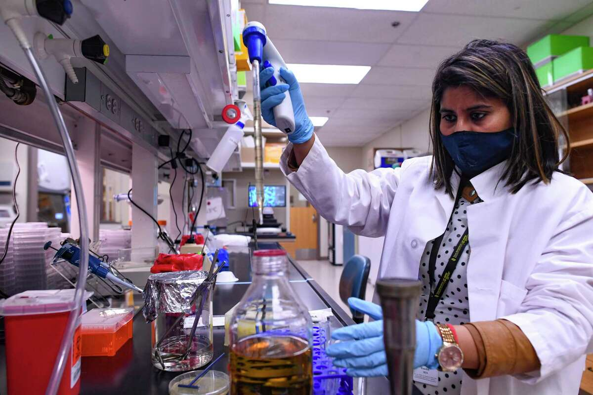 Nidhi Kaushik works on inoculating bacterial colonies expressing coronavirus proteins as part of the research happening at the Texas Biomedical Research Institute on Monday, April 19, 2021. The institute has received two Department of Defense subcontracts totaling $1.95 million aimed at identifying viral and microbial decontamination strategies that can clean surfaces and improve indoor air quality to rid them of deadly pathogens such as the coronavirus that causes COVID-19.