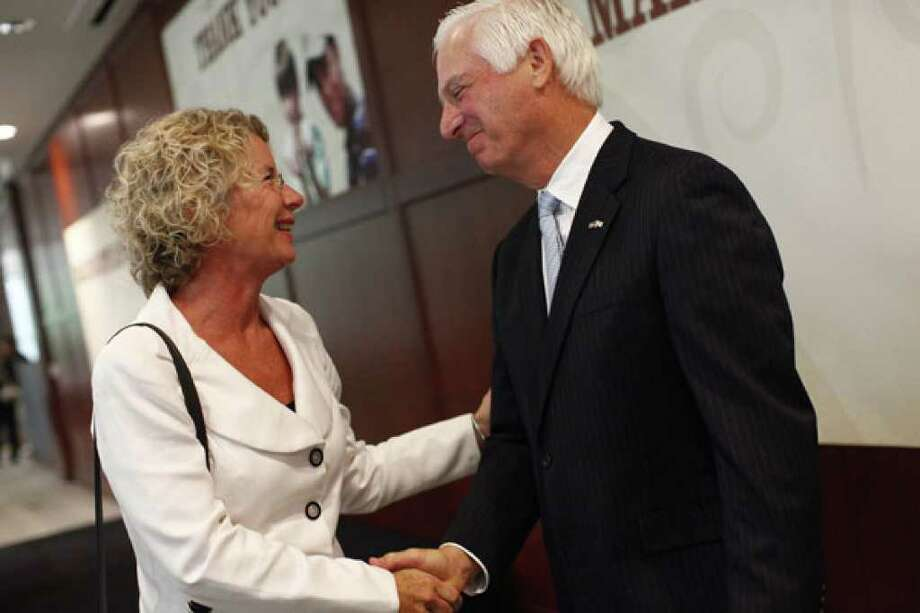 Kim Abernethy shares a moment with Valero Chairman and CEO Bill Klesse after accepting a check for Child Safe.