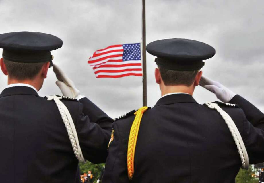 Christian Brothers Academy  cadets Christian Dallard and Taylor Dugan salute the American flag during a remembrance ceremony of 9/11, at the school in Colonie Friday, September 10, 2010.  (John Carl D'Annibale / Times Union) Photo: John Carl D'Annibale / 00010209A