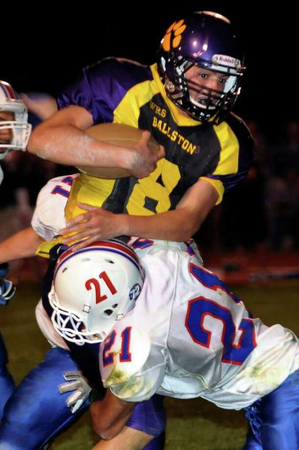 High school football -- Ballston Spa's Troy Gargiulo, right, is stoped by Saratoga's Victor Perez (21) during  the second half. (Hans Pennink / Special to the Times Union) Photo: Hans Pennink