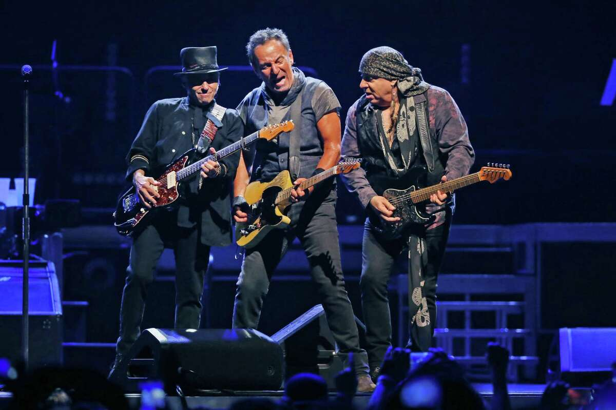 From left, Nils Lofgren, Bruce Springsteen and Steven Van Zandt, of the E Street Band, perform on Sunday, Aug. 28, 2016 at the United Center in Chicago.