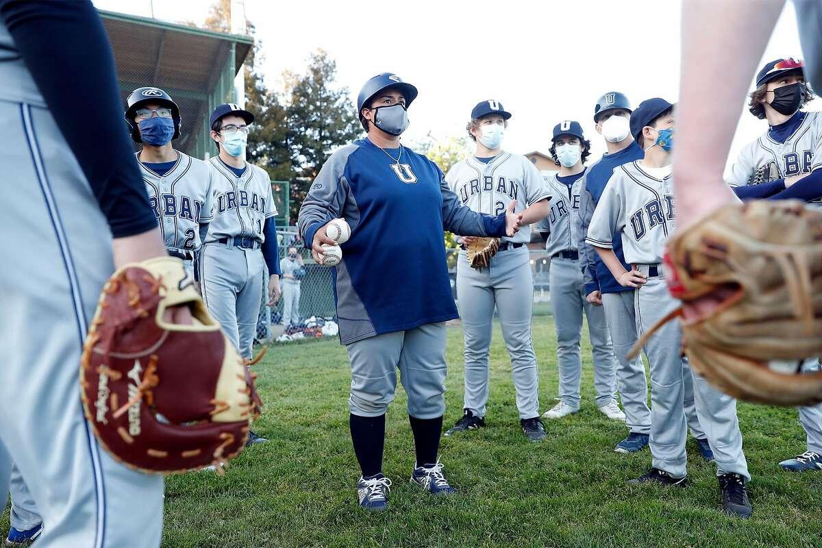 Urban School of San Francisco baseball coach Oz Sailors gives her team a pep talk against San Domenico High of San Rafael.