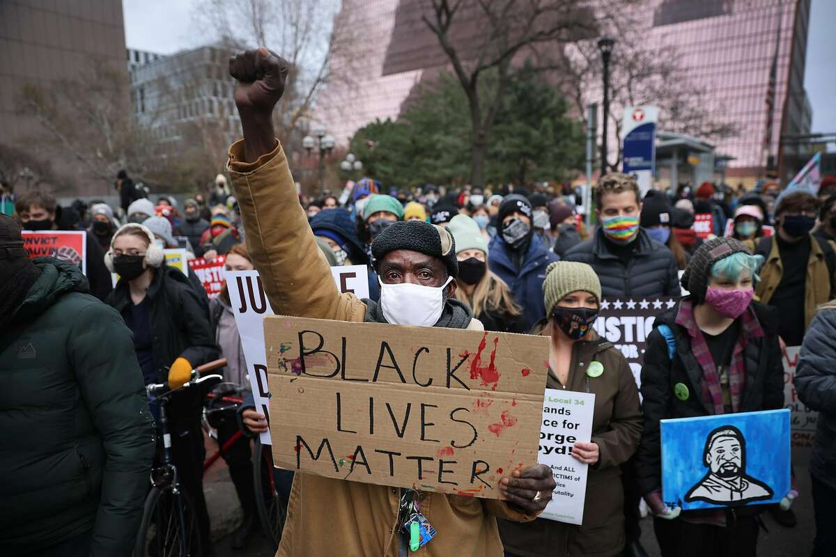 Demonstrators protest near the Hennepin County Courthouse on April 19, 2021 in Minneapolis, Minnesota.