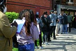 Local residents line up for the The Griffin Hospital mobile COVID-19 vaccination clinics at the Norwalk Public Library main branch on Belden Ave. Tuesday, April 20, 2021, in Norwalk, Conn. The mobile clinic will be at several locations in Norwalk this week.