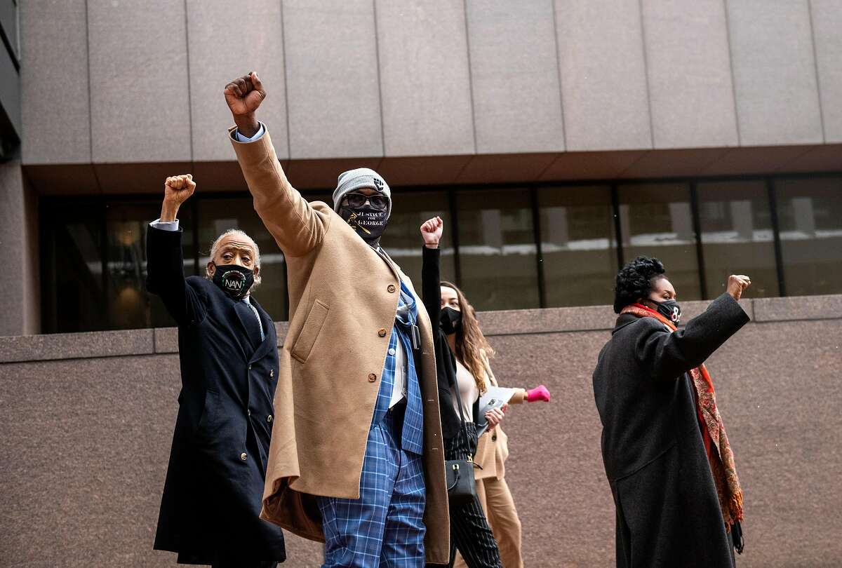 Rev. Al Sharpton (L), Philonise Floyd, brother of George Floyd (2nd L) and Rep. Sheila Jackson Lee (D-TX) (R) arrive at the Hennepin County Government Center on April 19, 2021 in Minneapolis, Minnesota.