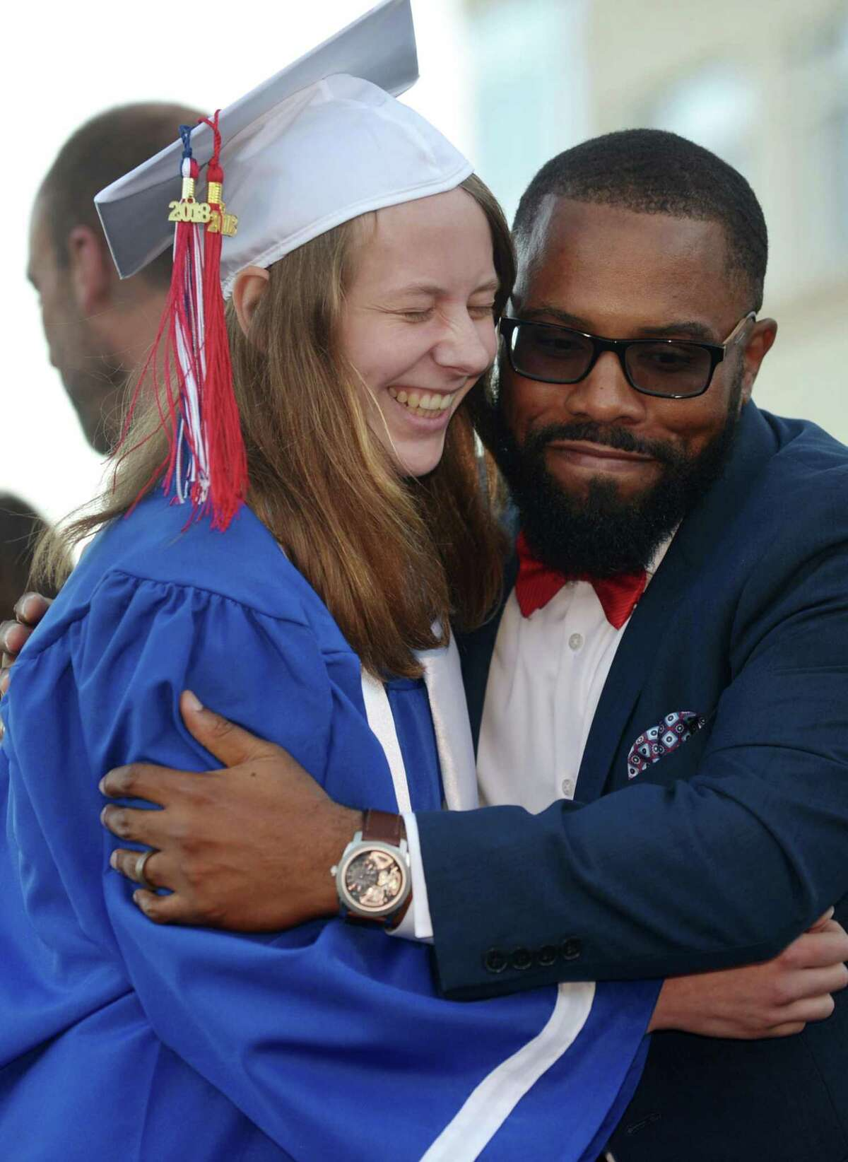 Hayley Linder celebrates the graduation of the Class of 2018 with Assistant Principal Qadir Abdus-Salaam during the Brien McMahon commencement exercises Tuesday, June 19, 2018, in Norwalk, Conn.