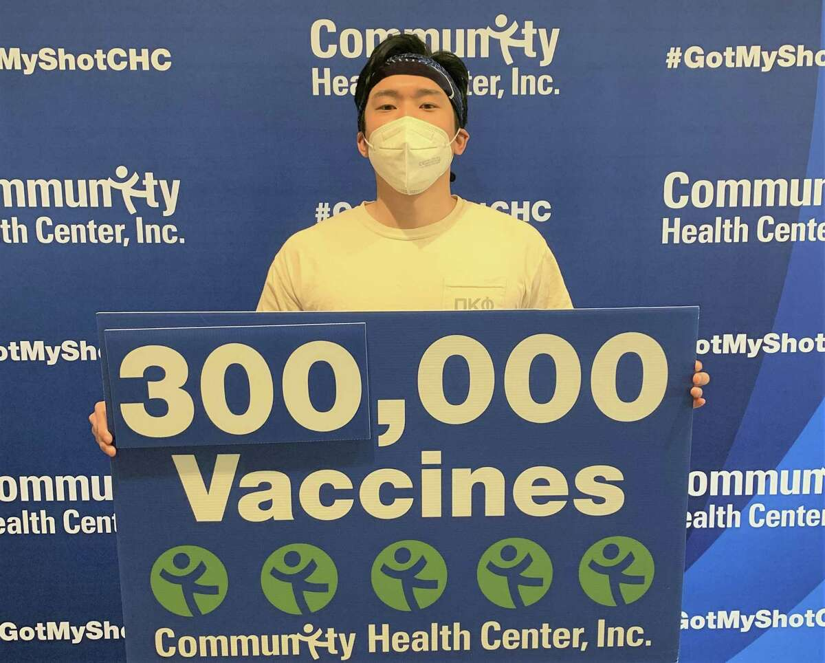 Edward Cho of Middletown received the Comunity Health Center's 300,000th COVID-19 vaccine shot Tuesday.