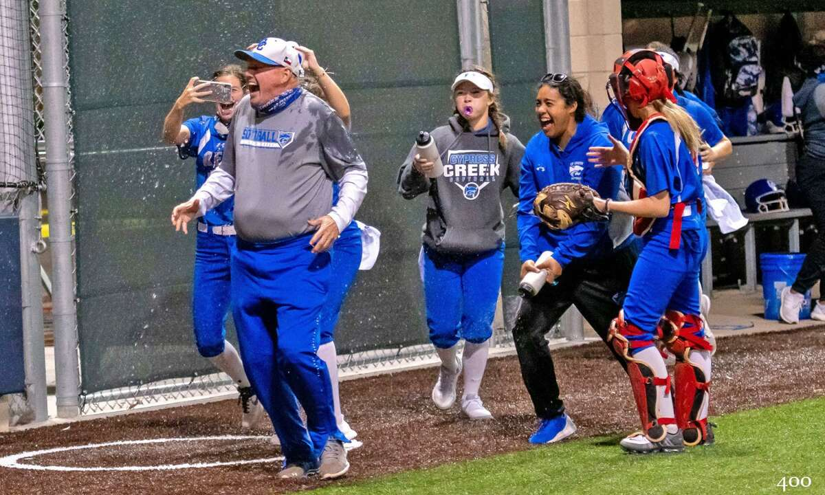 Cypress Creek softball players celebrate with Coach Kight after his 400th victory. (Photo courtesy Battle Media Pictures)