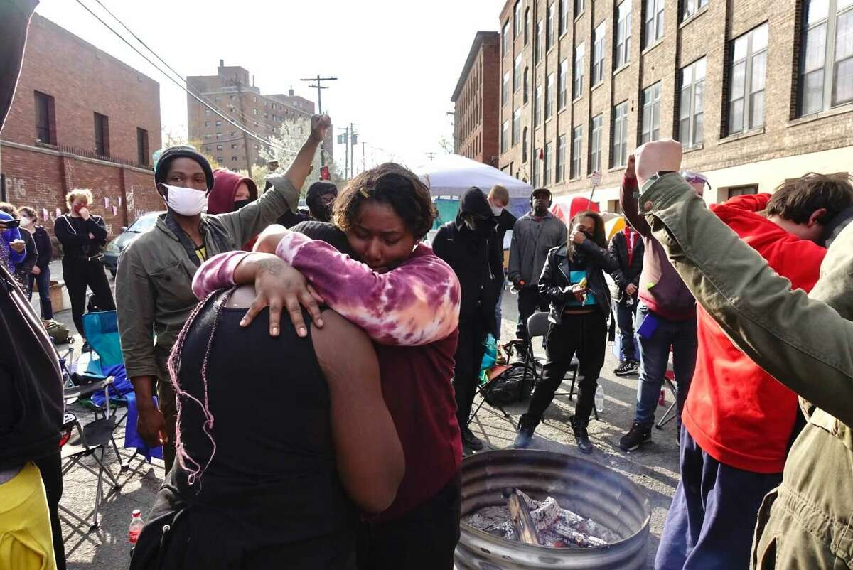 People outside the Albany Police Department's South Station rejoiced and embraced as ex-Minneapolis Police Officer Derek Chauvin was convicted of murder in the May 25, 2020 death of George Floyd.