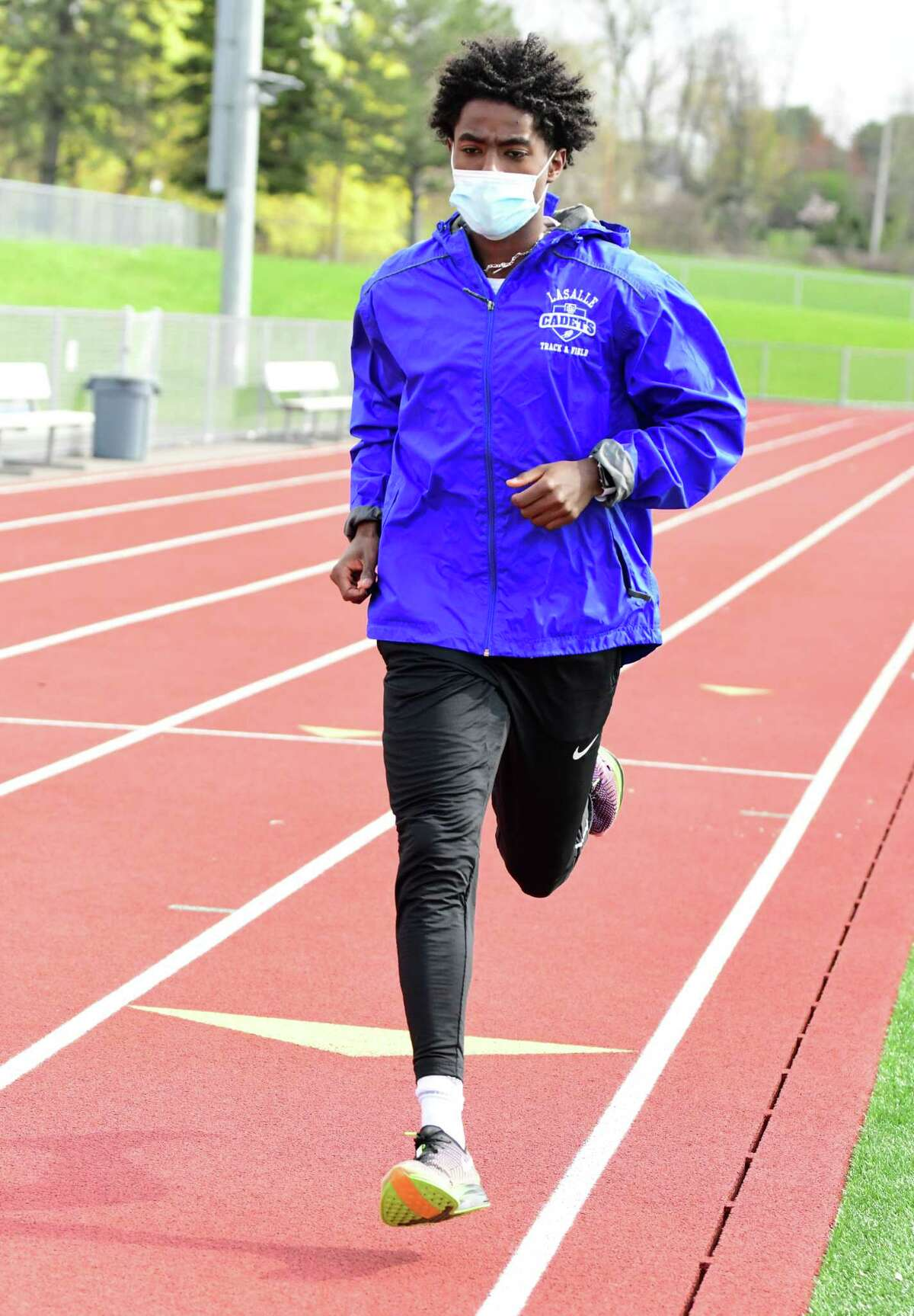 La Salle's Gitch Hayes warms up on the track before a race against Lansingburgh on April 20, 2021. Hayes was the top 1,600-meter runner in Section II and the Athlete of the Year in boys' track and field.