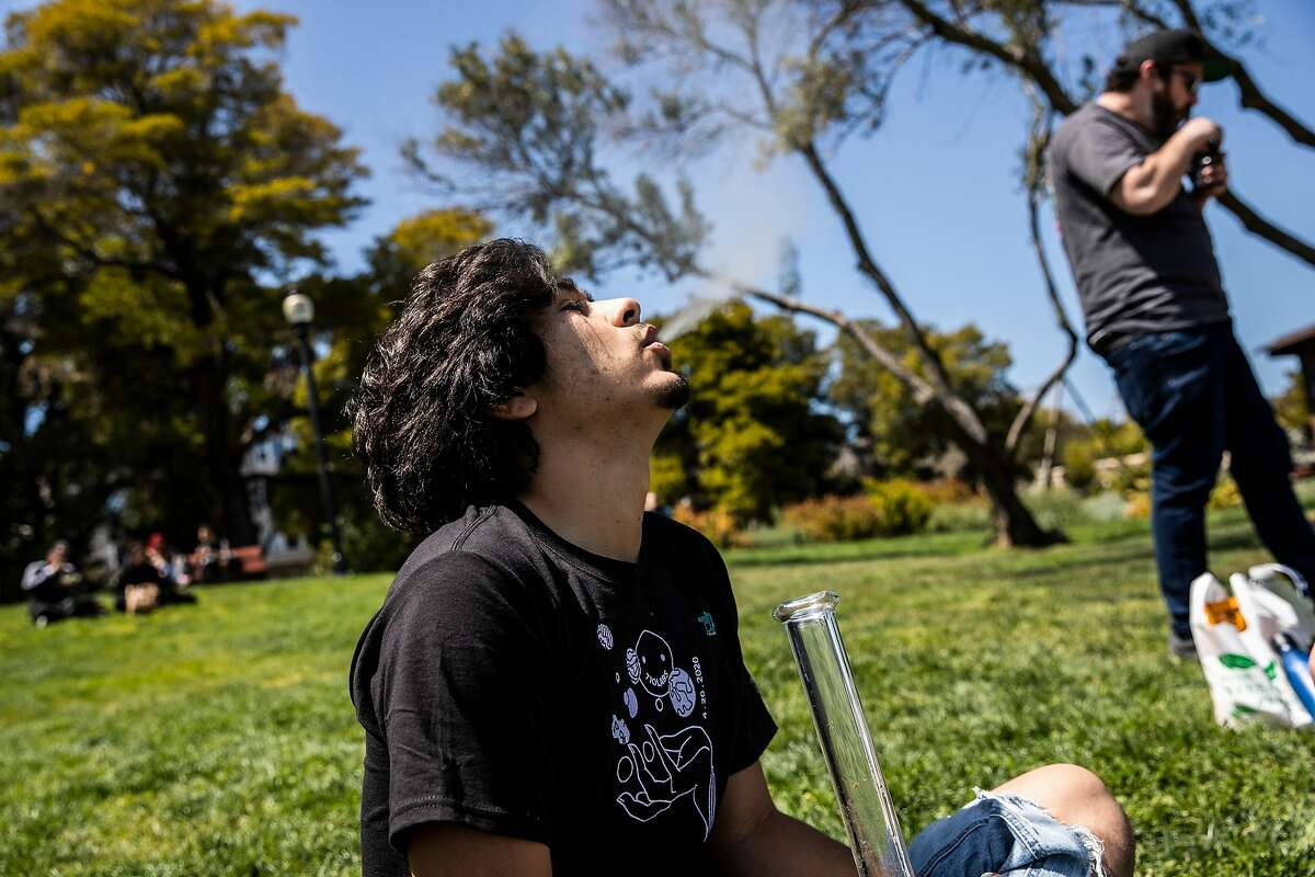 Ernie Gonzales exhales while consuming marijuana during the annual observance of 4/20 for cannabis consumption at Mission Dolores Park in San Francisco, California Tuesday, April 20, 2021.