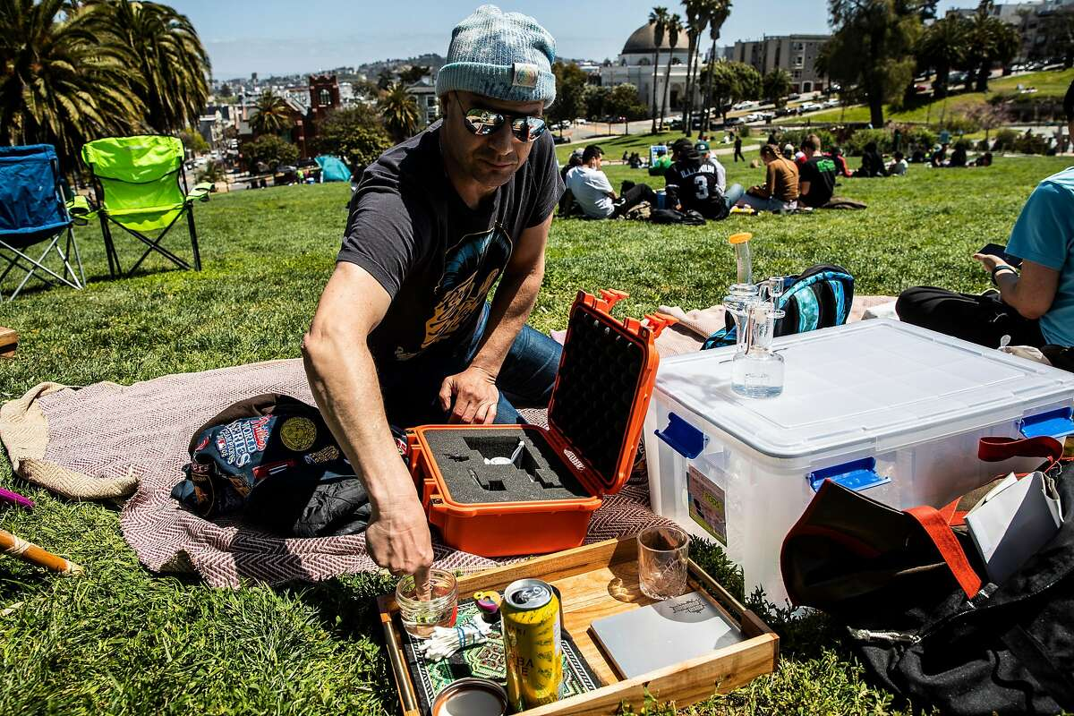 Andrew Kaufman of 710 Labs prepares to consume marijuana during the annual observance of 4/20 for cannabis consumption at Mission Dolores Park in San Francisco, California Tuesday, April 20, 2021.