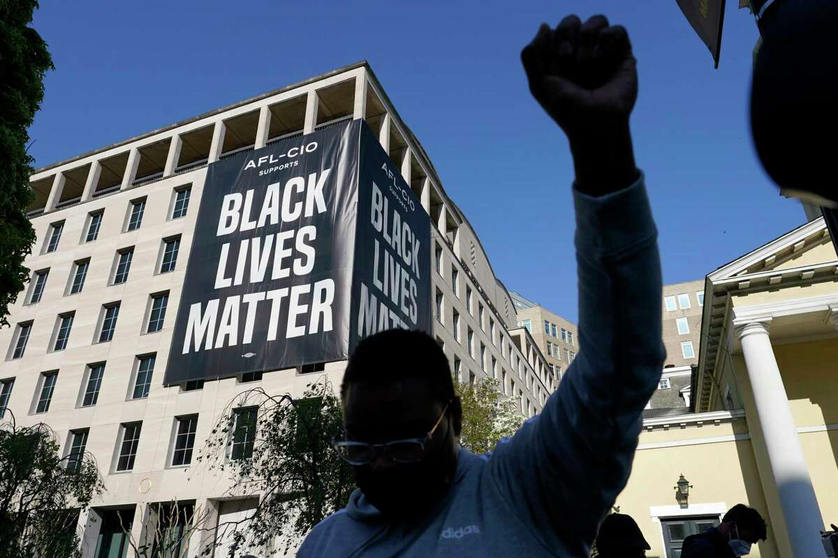 A person reacts on Tuesday, April 20, 2021, in Washington, at Black Lives Matter Plaza near the White House after the verdict in Minneapolis, in the murder trial against former Minneapolis police officer Derek Chauvin was announced.