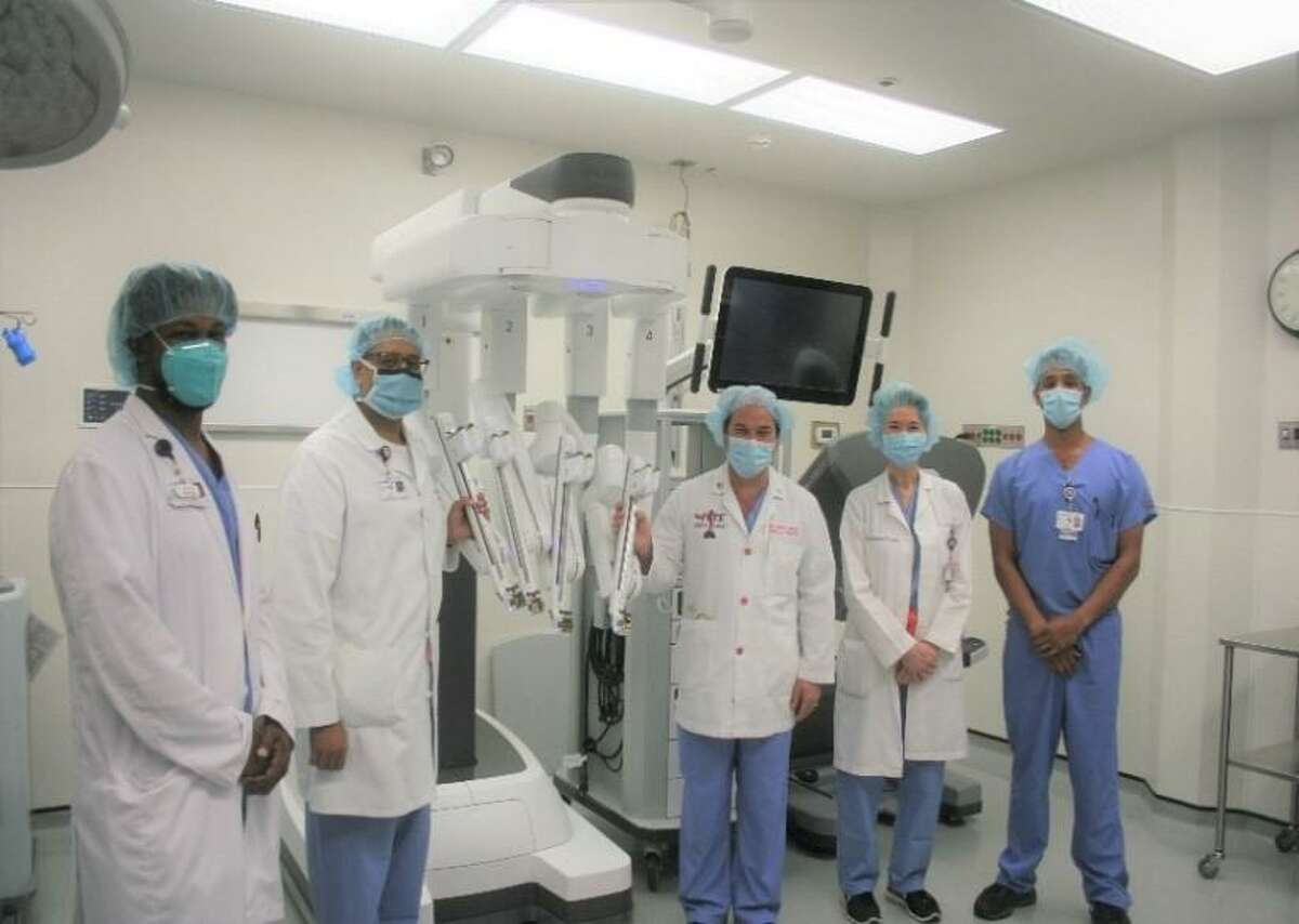 Staff involved in HCA Houston Healthcare Tomball's robotiic surgery program, which was recently awarded accreditation by the Surgical Review Corproation. Pictured from left to right: Jantzen Thorns, M.D., Ata Ahmad, M.D., Brian Harkins, M.D., Marie Sohner, M.D., and Ronak Patel, D.O.
