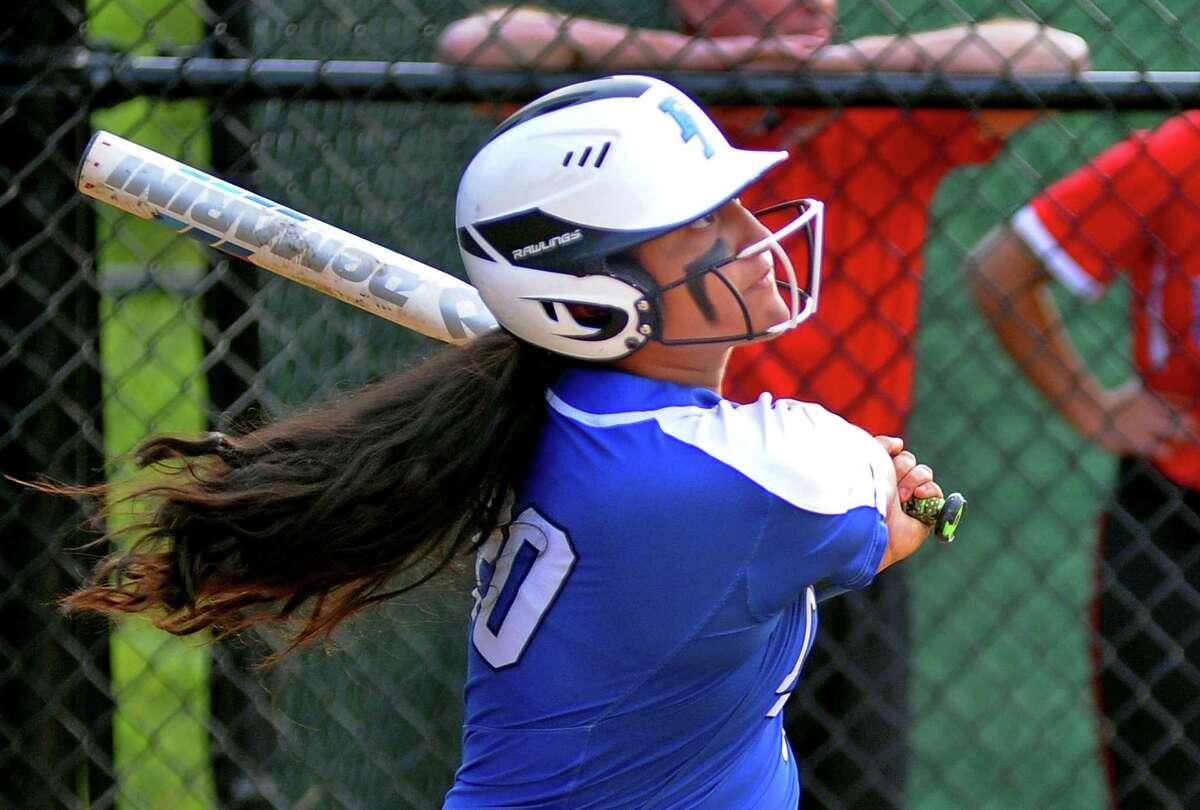 Fairfield Ludlowe's Caitlyn Romero (20) hits a 3-run homer in the final inning against Fairfield Warde in Fairfield in 2018.