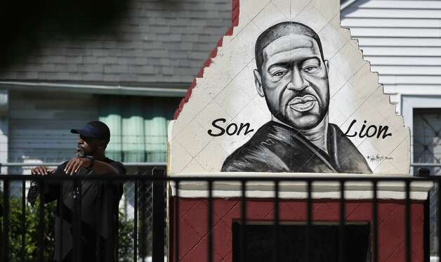 Dennis Glenn stands near a mural of George Floyd at Yates High School as they learn the guilty verdict on all counts in the murder trial of former Minneapolis Officer Derek Chauvin in the death of George Floyd on Tuesday, April 20, 2021, in Houston. Photo: Karen Warren/Staff Photographer / @2021 Houston Chronicle