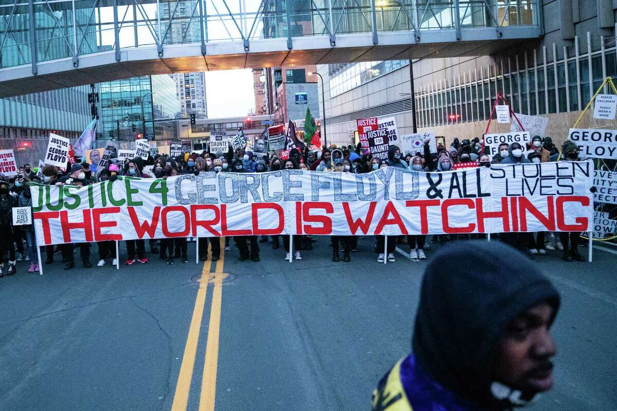 MINNEAPOLIS, MN - APRIL 19: Protesters march around downtown Minneapolis near the courthouse calling for justice for George Floyd after closing arguments in the Chauvin trial has ended on Monday, April 19, 2021 in Minneapolis, MN. (Jason Armond / Los Angeles Times via Getty Images)