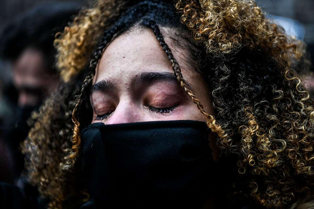 A woman cries as the verdict is announced in the trial of former police officer Derek Chauvin outside the Hennepin County Government Center in Minneapolis, Minnesota on April 20, 2021. - Sacked police officer Derek Chauvin was convicted of murder and manslaughter on april 20 in the death of African-American George Floyd in a case that roiled the United States for almost a year, laying bare deep racial divisions. (Photo by CHANDAN KHANNA / AFP) (Photo by CHANDAN KHANNA/AFP via Getty Images)