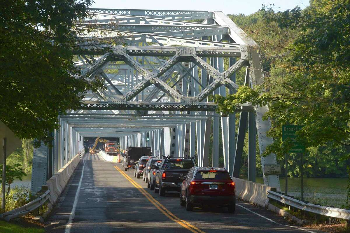 Traffic waits to cross the Lake Lillinonah Bridge, Route 133, on Tuesday morning. The bridge is reduced to one lane of traffic at a time and has had weekend closures/bypasses this summer. The CT DOT expects a final weekend closures/bypass as late as the first weekend in November. Tuesday, September 3, 2019, in Brookfield, Conn.