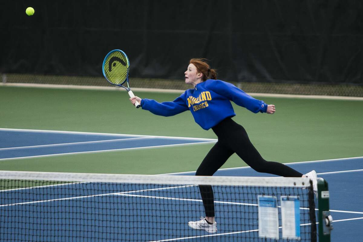 Midland's Kendal Gray competes in a #2 doubles match, alongside partner Natalie Gaffke, against opponents from Flint Powers Tuesday, April 20, 2021 at the Greater Midland Tennis Center. (Katy Kildee/kkildee@mdn.net)