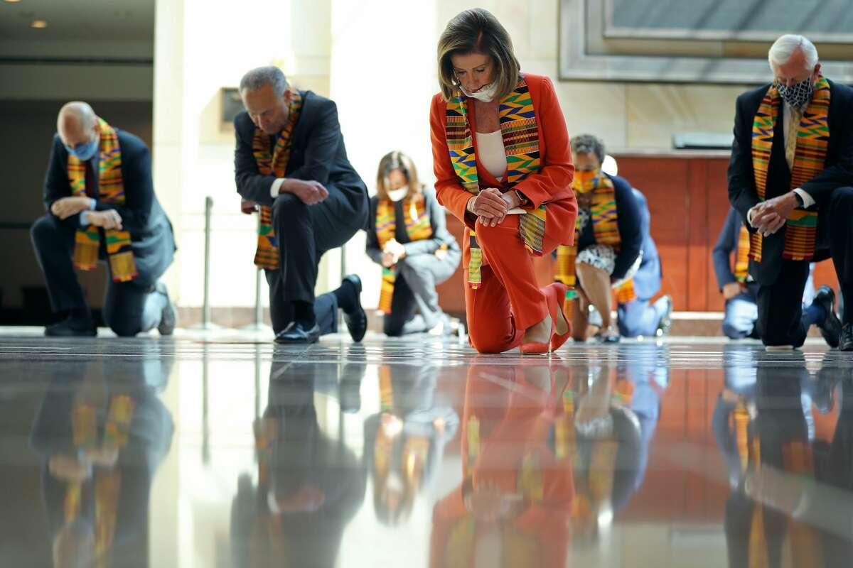 Speaker of the House Nancy Pelosi, D-Calif., joins fellow Democrats from the House and Senate to kneel in silence for eight minutes and 46 seconds to honor George Floyd in the U.S. Capitol Visitors Center on June 8, 2020, in Washington, D.C.