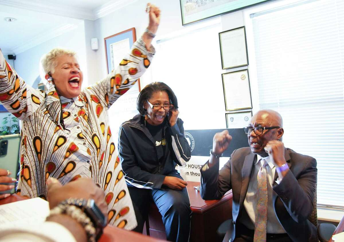 Houston City Council member Carolyn Evans-Shabazz, from left, NAACP Executive Director Yolanda Smith and NCAA President Bishop James Dixon react to the Derek Chauvin verdict at the Houston NAACP headquarters on Tuesday, April 20, 2021.