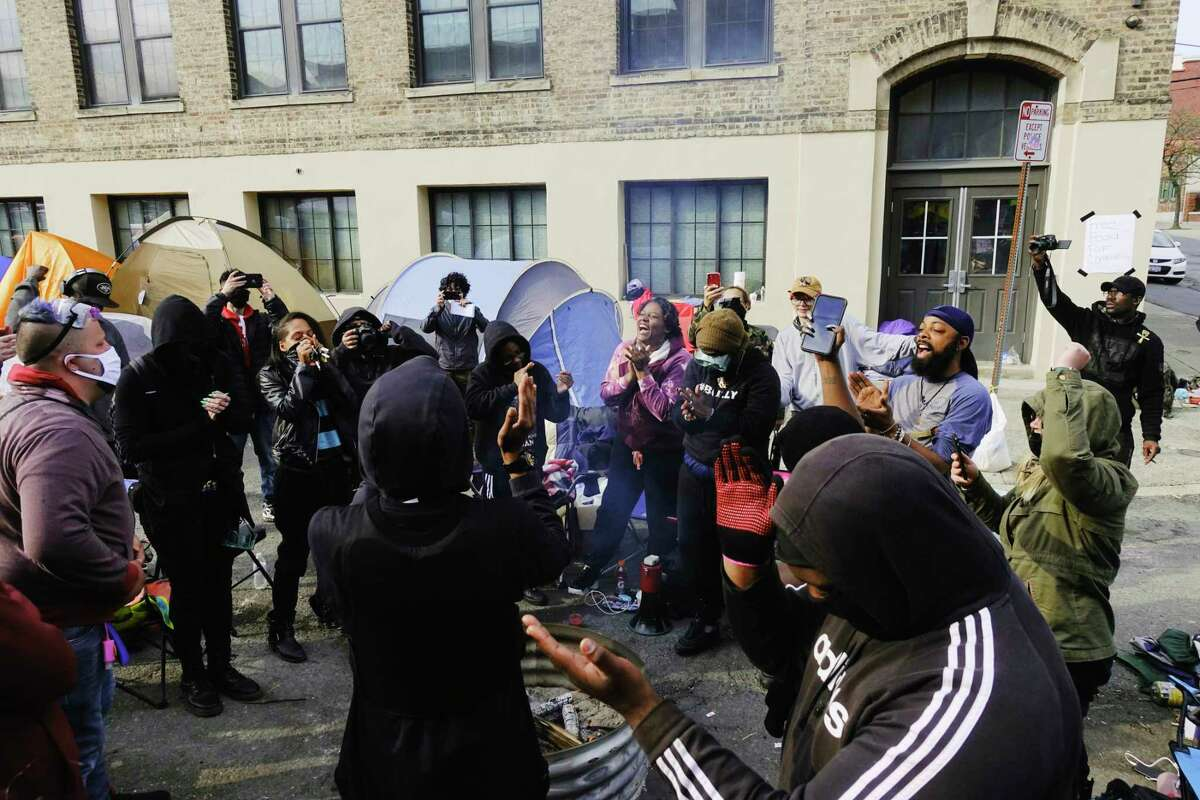 Black Lives Matter protestors celebrate the guilty verdict in the Derek Chauvin trial as they listened to the verdict being played through a speaker outside the South Station of the Albany Police on Tuesday, April 20, 2021, in Albany, N.Y. (Paul Buckowski/Times Union)