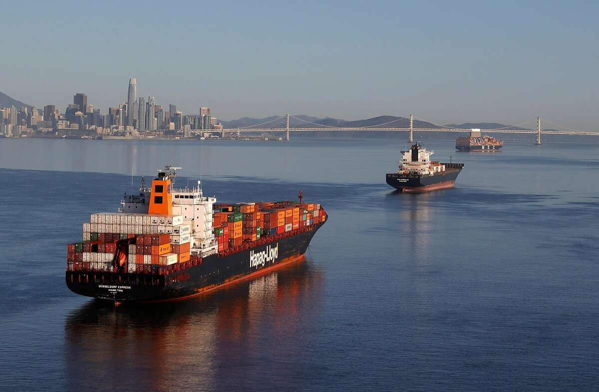 Container ships sit idle in the the San Francisco Bay just outside of the Port of Oakland on March 26, 2021.