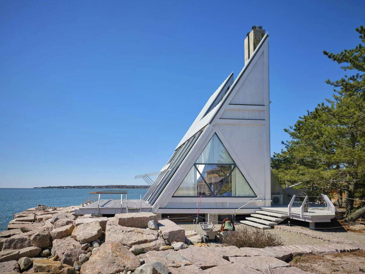 From a distance on the water, the Triangle House looks like a sailboat.