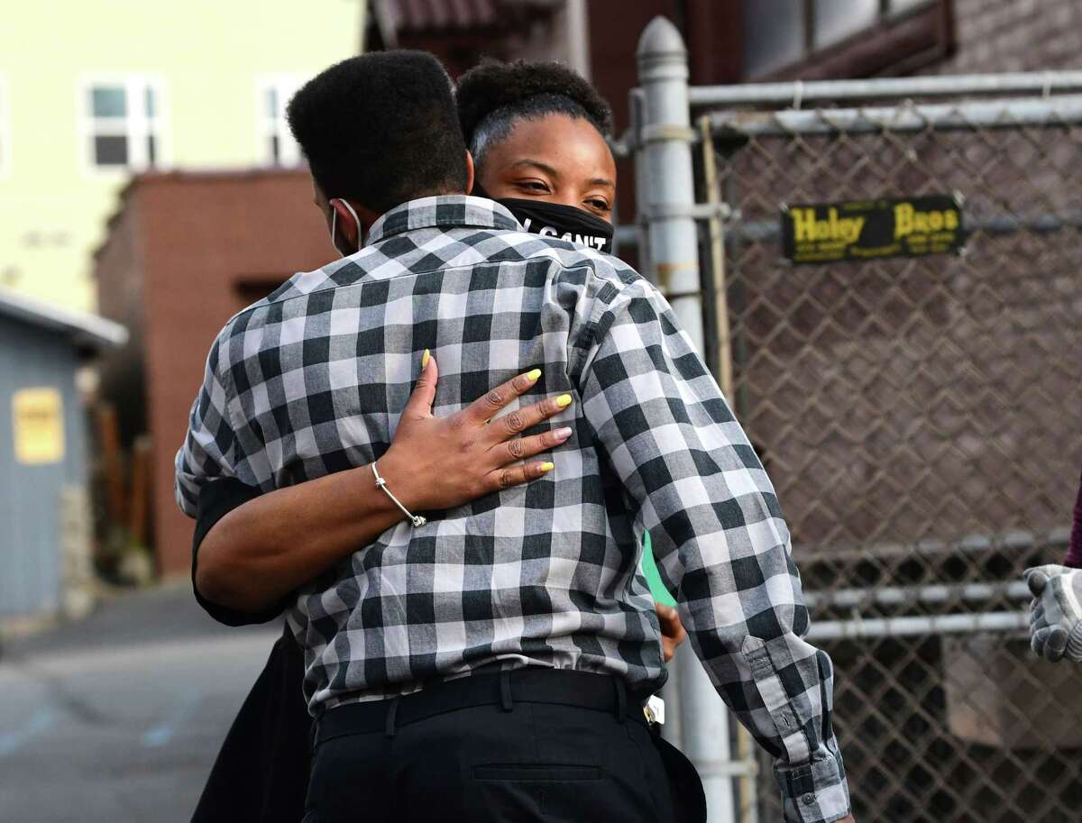 Pastor Nicolle Harris hugs Justin Chaires of Schenectady during a vigil at Duryee Memorial AME Zion Church following the verdict announcement in the Derek Chauvin trial on Tuesday, April 20, 2021 in Schenectady, N.Y. (Lori Van Buren/Times Union)