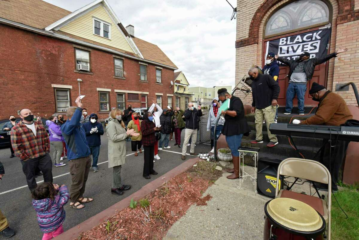 People clap in celebration before a vigil at Duryee Memorial AME Zion Church following the verdict announcement in the Derek Chauvin trial on Tuesday, April 20, 2021 in Schenectady, N.Y. (Lori Van Buren/Times Union)