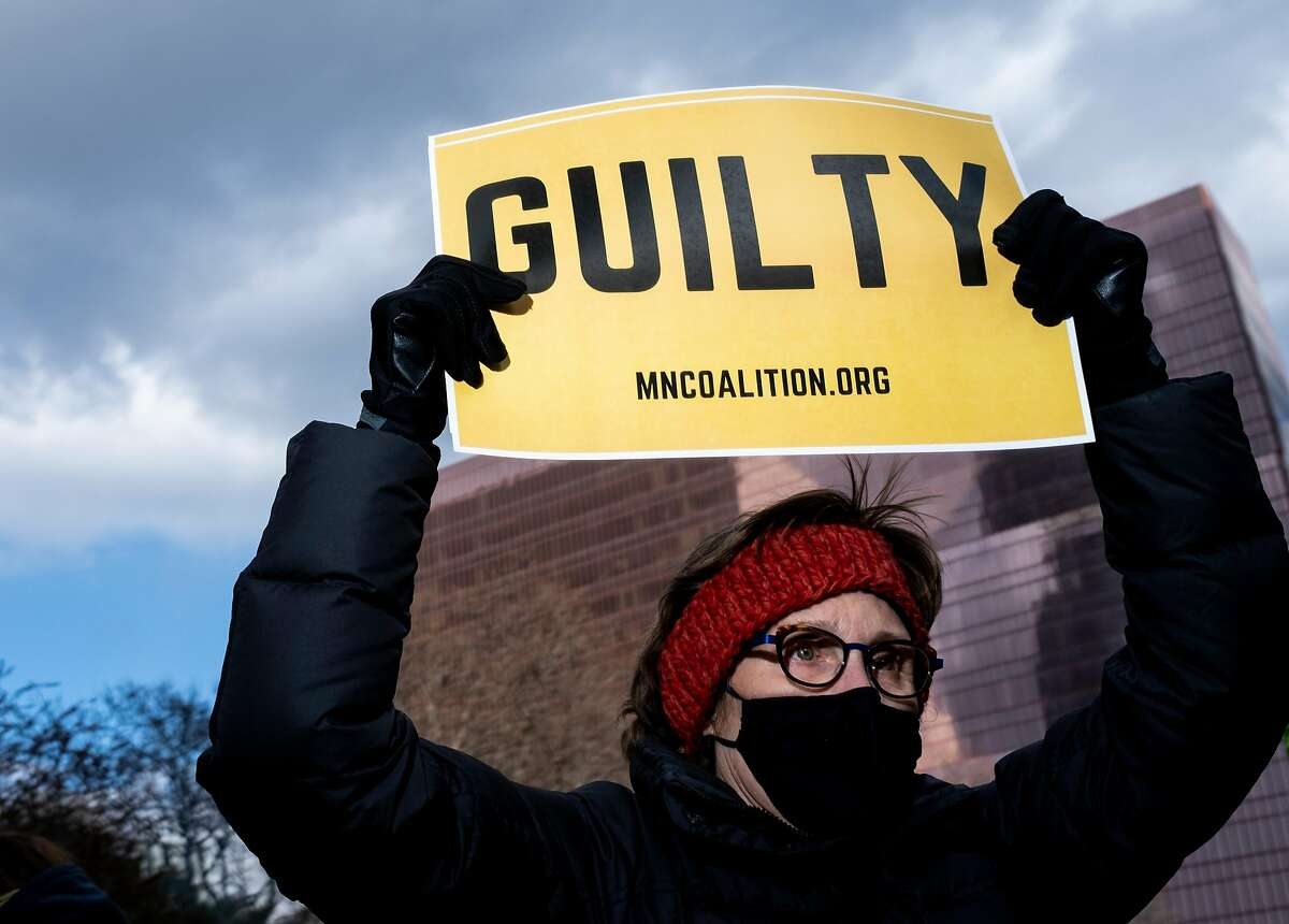 """MINNEAPOLIS, MN - APRIL 20: A person holds a sign that says """"Guilty"""" after the verdict was read in the Derek Chauvin trial on April 20, 2021 In Minneapolis, Minnesota.Former police officer Derek Chauvin was on trial on second-degree murder, third-degree murder and second-degree manslaughter charges in the death of George Floyd May 25, 2020. After video was released of then-officer Chauvin kneeling on Floyds neck for nine minutes and twenty-nine seconds, protests broke out across the U.S. and around the world. The jury found Chauvin guilty on all three charges. (Photo by Stephen Maturen/Getty Images)"""