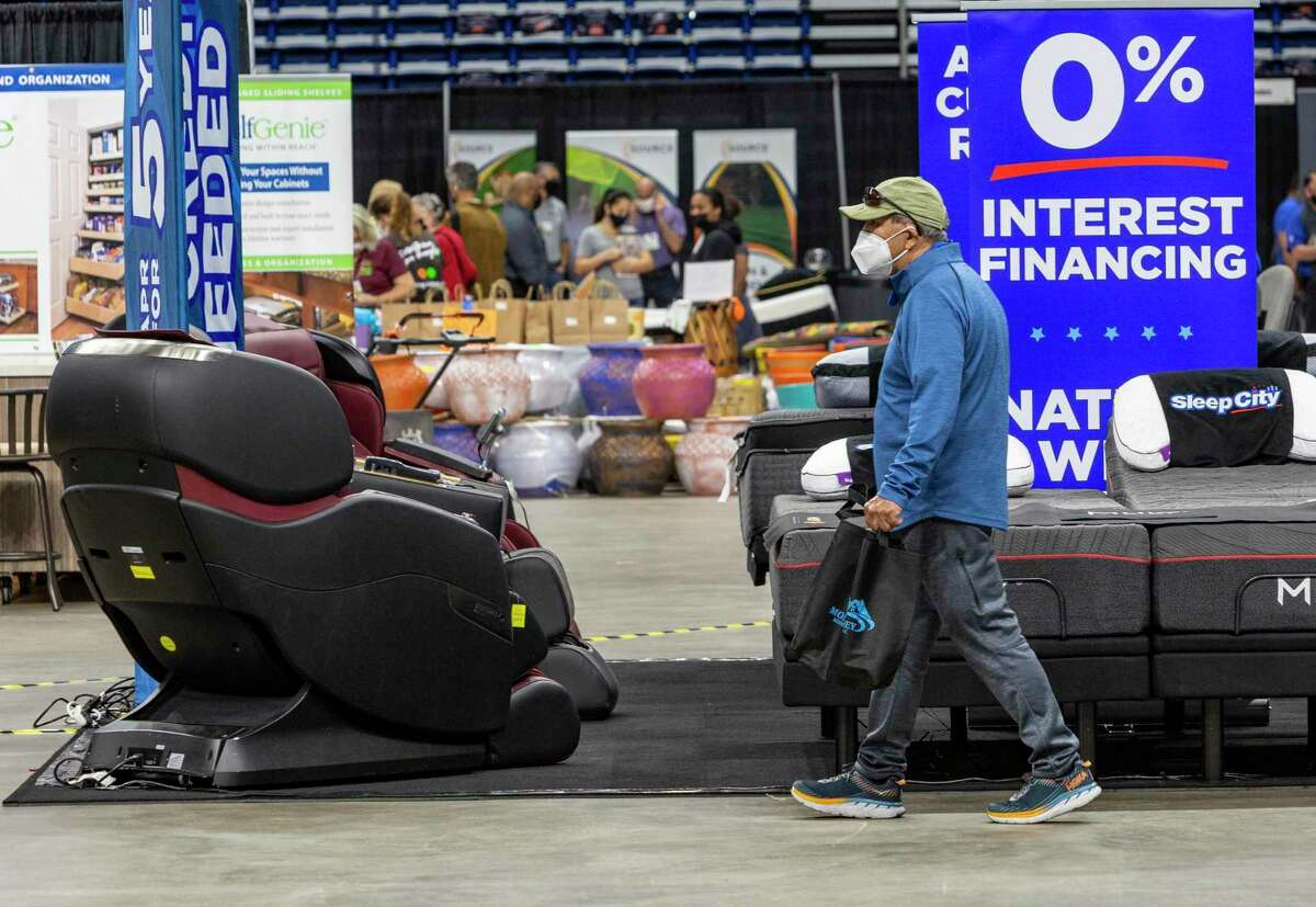 A man walks last Friday of the San Antonio Spring Home & Garden Show in the Alamodome. It was the first consumer show to be held in the Alamodome in more than a year, and social distancing and mandatory mask wearing were enforced.