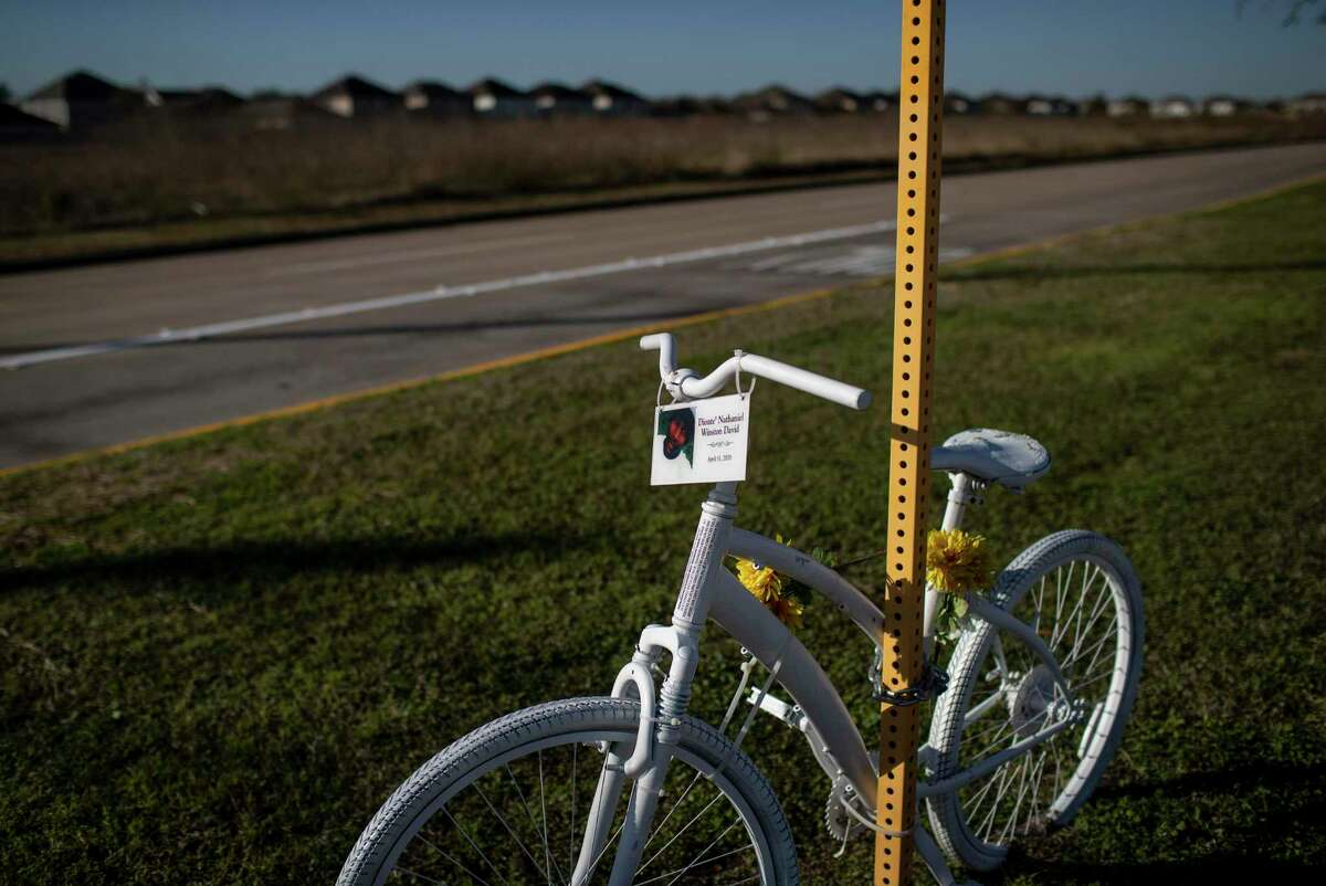 A ghost bike in memory of Dionte' Nathaniel Winston David sits at the corner of North Fry Road and Kieth Harrow Boulevard on Jan. 14, 2021, in Katy. A cyclist was killed Sunday in Houston in a hit and run crash.