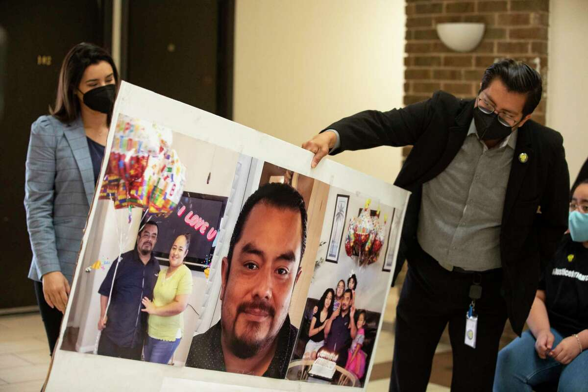 FIELl Executive Director Cesar Espinosa brings out a board compiled of enlarged photographs of Marcelo Garcia at a press conference calling Harris County Sheriff Ed Gonzalez to realease the body camera footage of Garcia's case Monday, April 19, 2021, in Houston. Garcia, 45, was shot and killed by a sheriff's deputy during an mental health crisis. Family said they called the mental health unit but a sheriff's deputy responded instead.