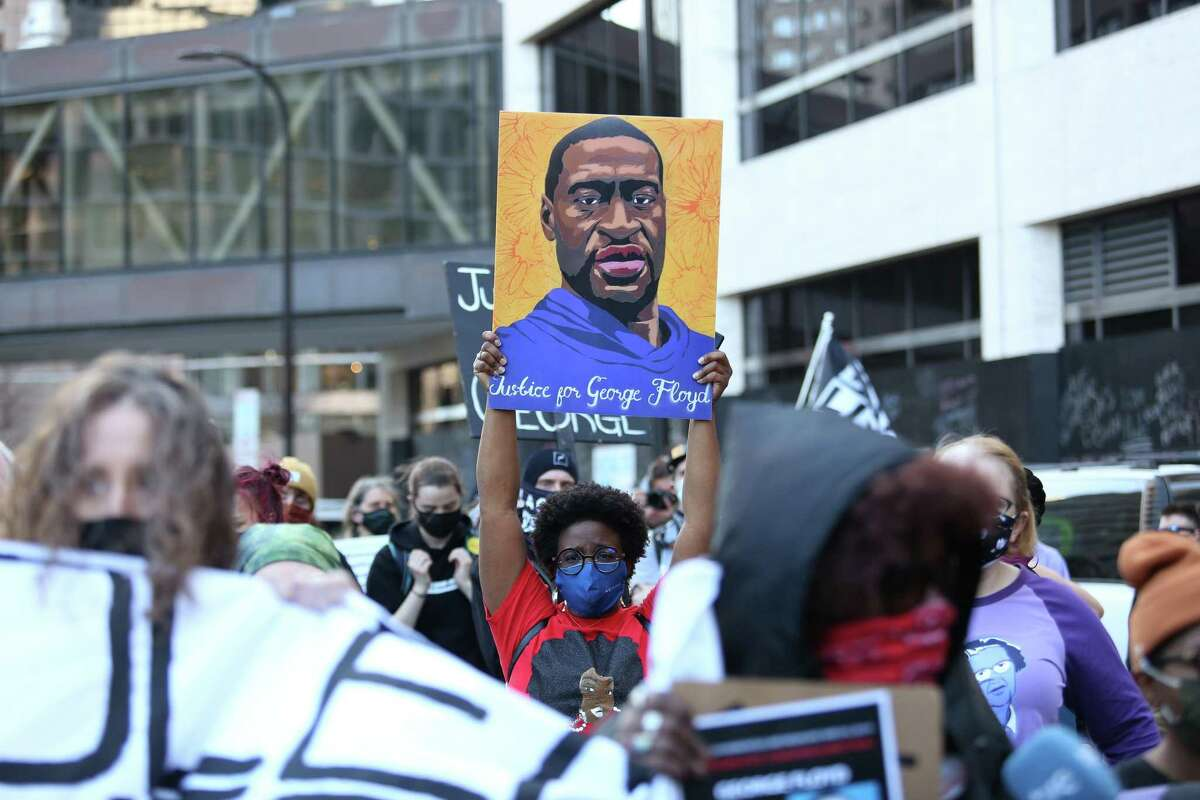 Demonstrators call for justice in March for the murder of George Floyd by former Minneapolis officer Derek Chauvin. Justice was delivered Tuesday.