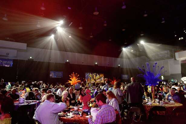 """Guests enjoy the festivities at the Gift of Life's annual Champagne and Ribs fundraiser at the Civic Center. The event, themed """"Viva, Las Vegas,"""" raises money for the Men's Health & Prostate Cancer Program. Photo taken Thursday, April 5, 2018 Kim Brent/The Enterprise"""