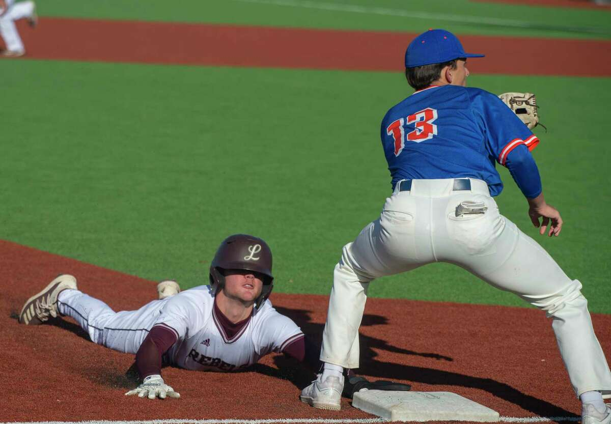 Lee High's Trevor Roper safely steals third on a double steal play as San Angelo Central's Dylan Abbott waits on the throw from home 04/20/2021 at Ernie Johnson Field Tim Fischer/Reporter-Telegram
